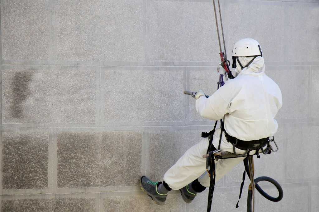 Rope,Access,Facade,Maintenance;,A,Worker,Wearing,A,Protective,Gear